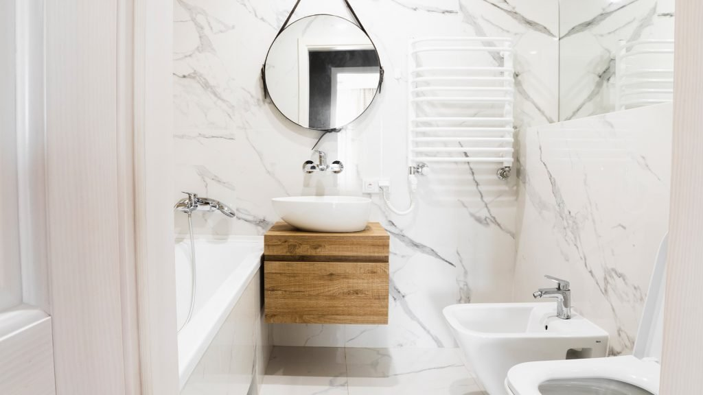 remodeled bathroom with marble tiles