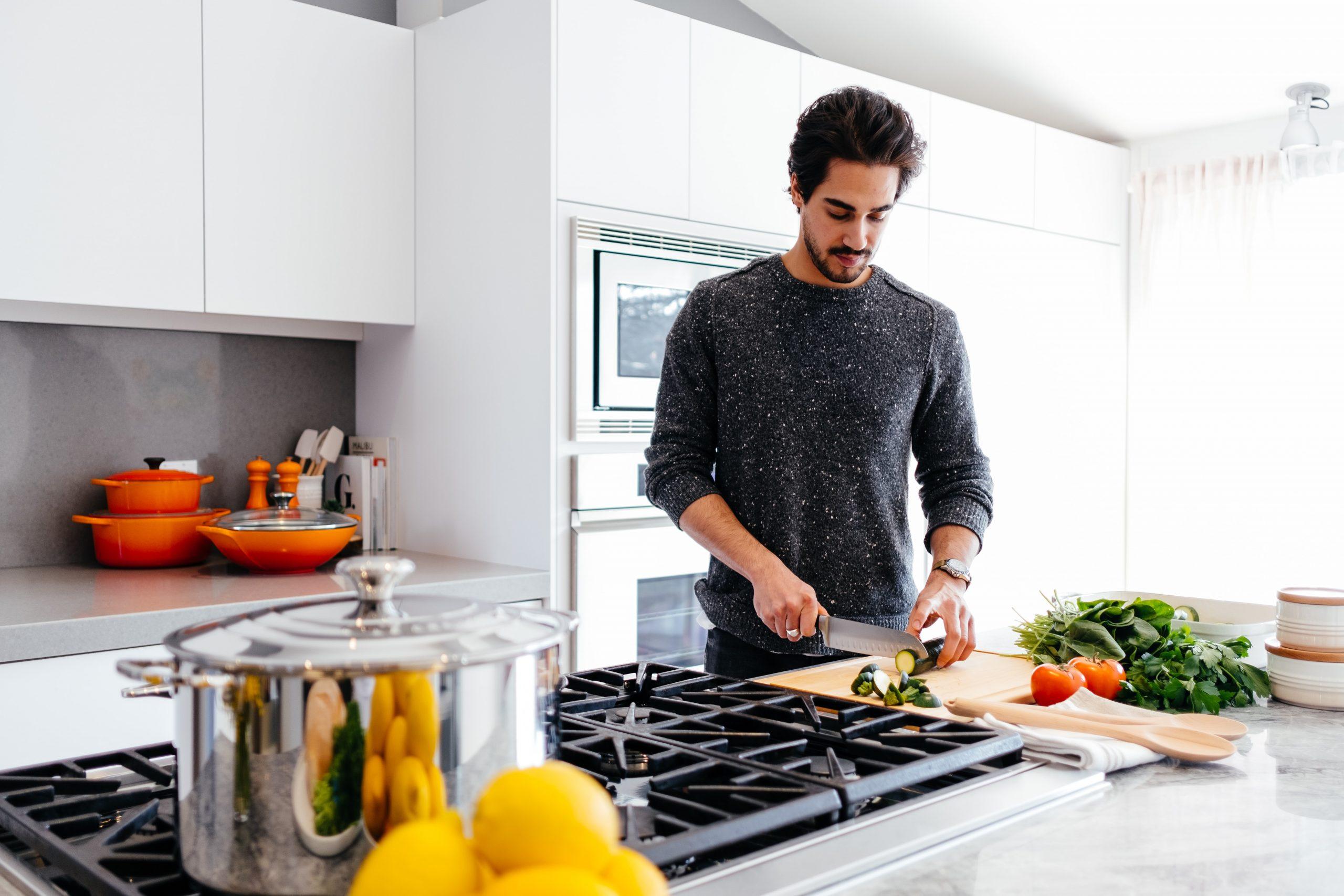 Man preparing food in a new kitchen