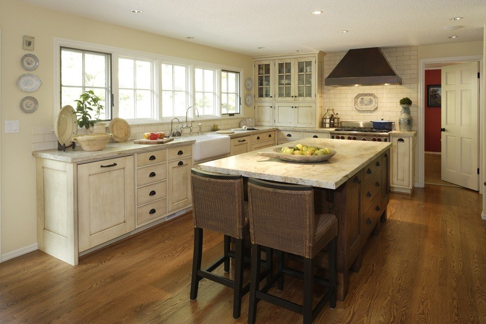 Distressed White Kitchen Cabinets With Marble Countertops
